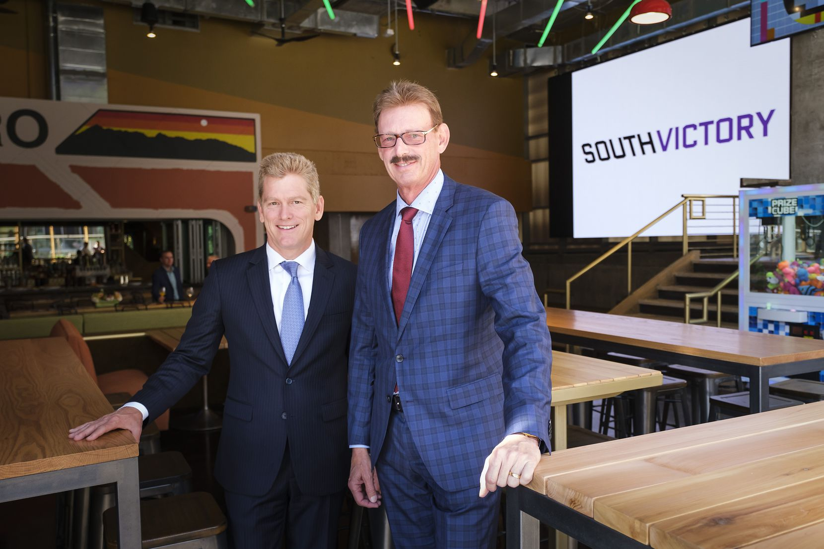 Victory Park president and owner Lothar Estein (right) and Lance Fair, chief operating officer and chief investment officer of Estein USA,  were in Dallas this week to celebrate the project's success 10 years after it faced foreclosure.