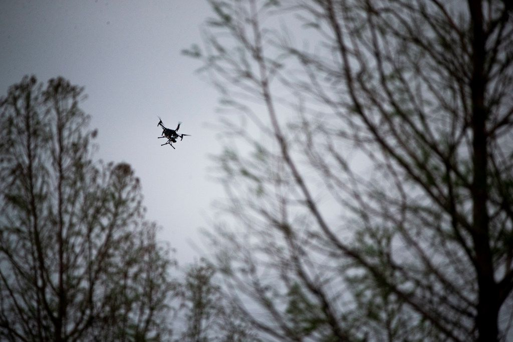 Authorities uses a drone at La Valencia at Starwood, where a shooting suspect was at large Friday evening.