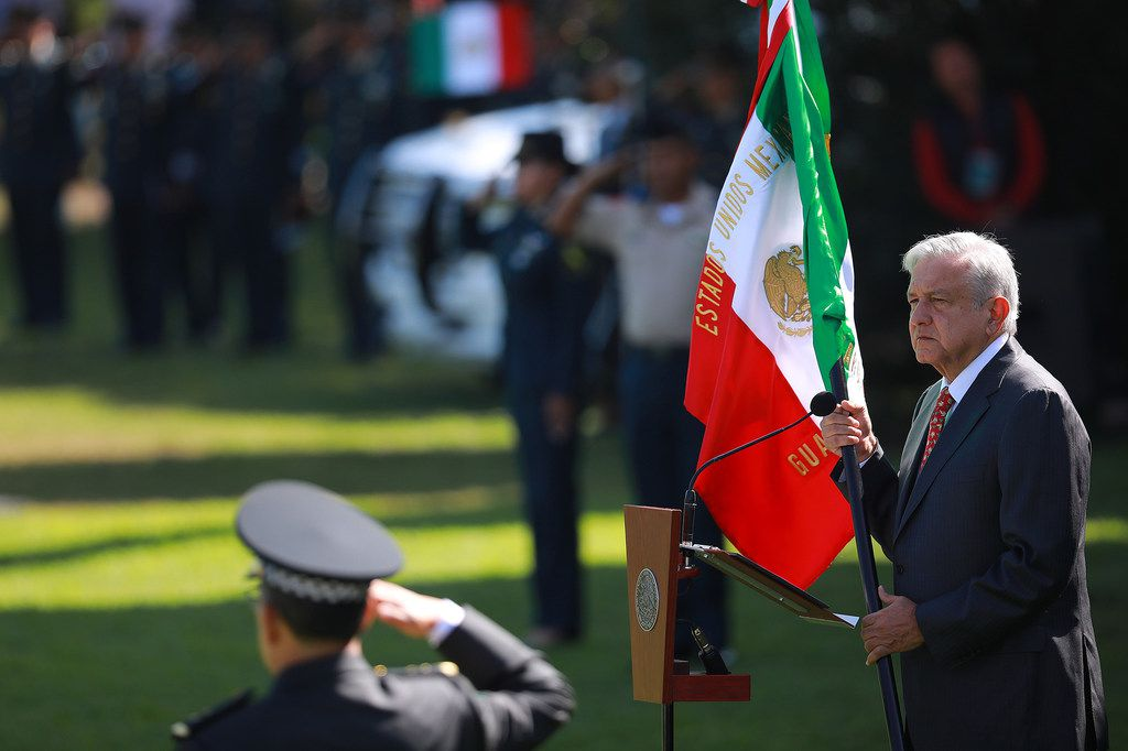 President of Mexico Andres Manuel Lopez Obrador holds the Mexican flag during the ceremony of deployment of the new Mexican security force 'National Guard' at Campo Marte on June 30, 2019, in Mexico City.