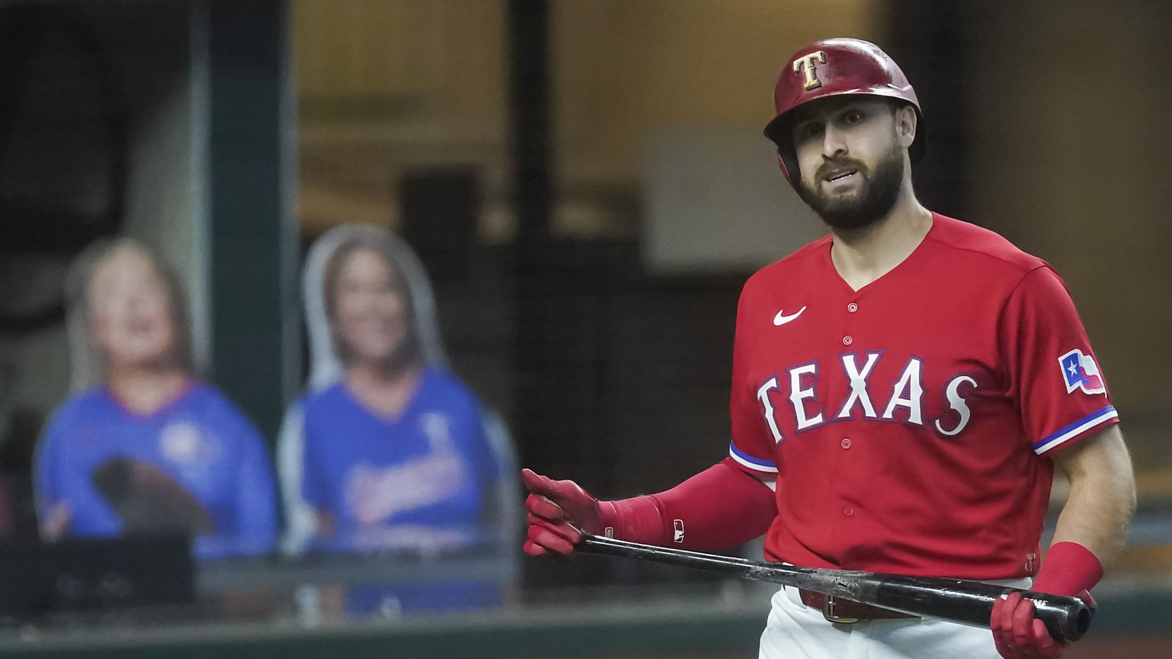 Texas Rangers outfielder Joey Gallo heads back to the dugout after a called third strike with the bases loaded during the third inning against the Los Angeles Dodgers at Globe Life Field on Sunday, Aug. 30, 2020.