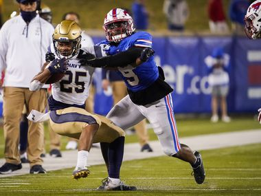 SMU linebacker Shaine Hailey (9) brings down Navy running back Carlinos Acie (25) during the fourth quarter of an NCAA football game at Ford Stadium on Saturday, Oct. 31, 2020, in Dallas. (Smiley N. Pool/The Dallas Morning News)
