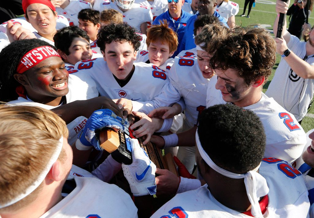 Parish Episcopal's Preston Stone (2) and teammates touch the trophy after receiving it during the awards presentation after defeating Plano John Paul II 42-14 in the TAPPS Division I State Championship game at Waco Midway's Panther Stadium in Hewitt, Texas on Friday, December 6, 2019. (Vernon Bryant/The Dallas Morning News)