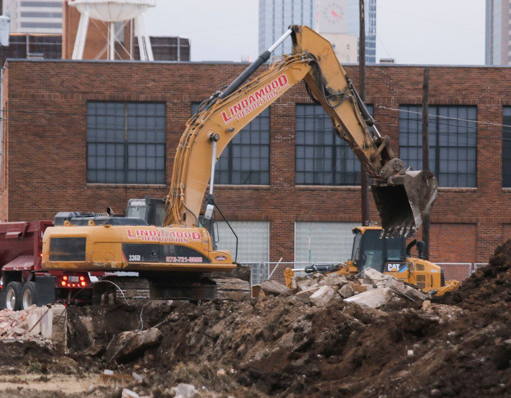 A backhoe moves dirt on the new multi-use development at 2900 block of Canton Street in Deep Ellum Friday, January 26, 2018. The seven story mix-used development will bring apartments and retail to the area.