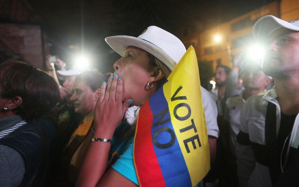 """""""No"""" supporters gathered Sunday at a rally in Bogota, Colombia, following their victory in the referendum on a peace accord to end the 52-year-old guerrilla war between the FARC and the state. (Mario Tama/Getty Images)"""