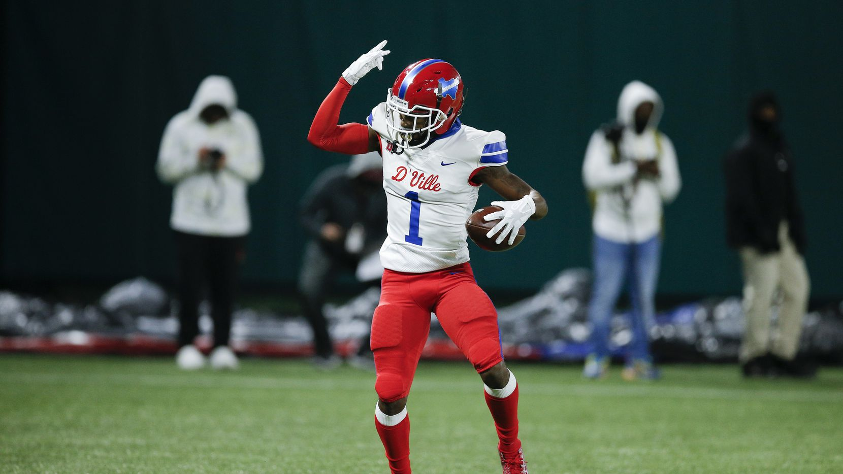 Duncanville senior running back Chris Hicks celebrates a touchdown during the first half of a Class 6A Division I Region II final high school football game against DeSoto, Saturday, January 2, 2021.