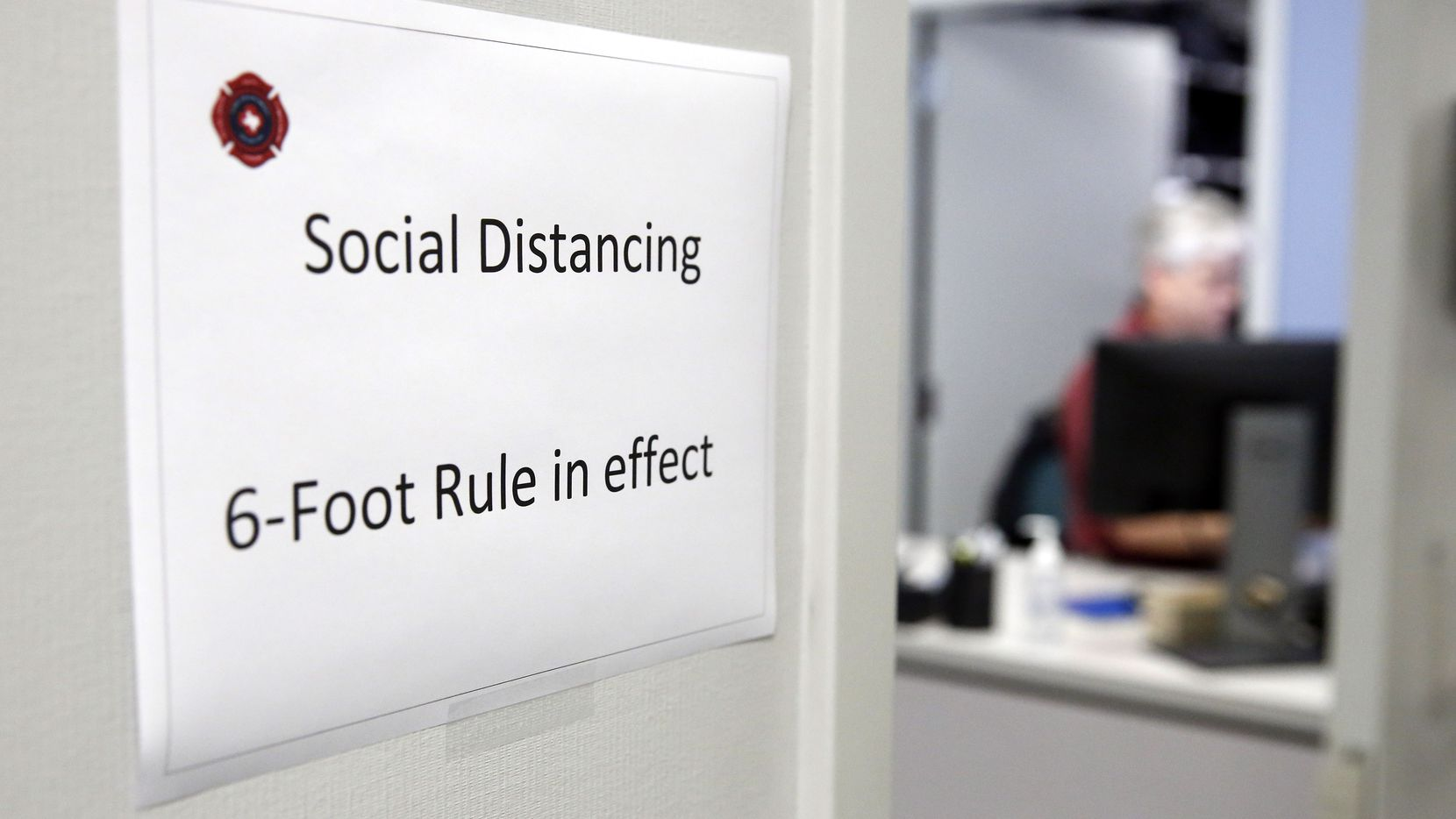 Signs outside the each office door of the Ott Cribbs Safety Center reminds workers to keep a social distancing of 6-feet, Wednesday March 18, 2020. Safe social distancing practices are even more important for individuals more susceptible to infection due to being immunocompromised.