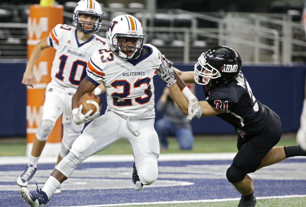 Frisco Wakeland's Jay Orji (23) runs the ball around Chance Miller (31) at AT&T Stadium in Arlington, Texas November 14, 2015.    (Nathan Hunsinger The Dallas Morning News)