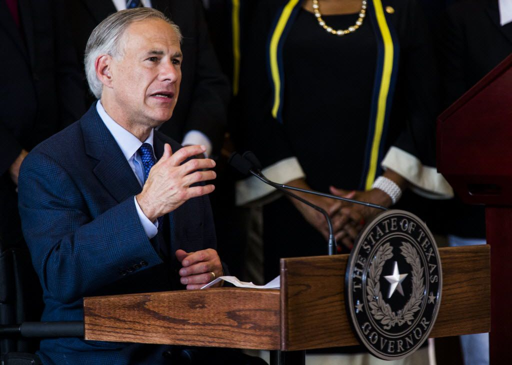 Texas Governor Greg Abbott speaks during a press conference on Friday, July 8, 2017 at Dallas City Hall in downtown Dallas, Texas. He and Dallas Mayor Mike Rawlings (not pictured) stood in front of a group of Dallas city councilmen, state representatives, state senators and Texas Attorney General Ken Paxton. They made comments about a shooting on Thursday, July 7, 2016 in downtown Dallas that targeted police officers and left five people dead and seven more injured. (Ashley Landis/The Dallas Morning News)