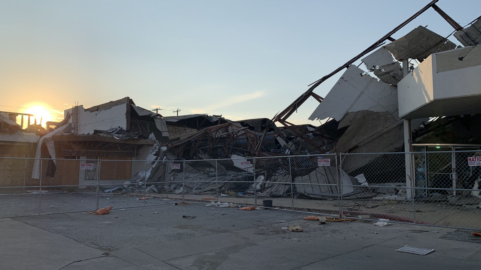 The sun sets on the ruins of the shopping plaza at Walnut Hill and Marsh lanes in Dallas in August 2020.