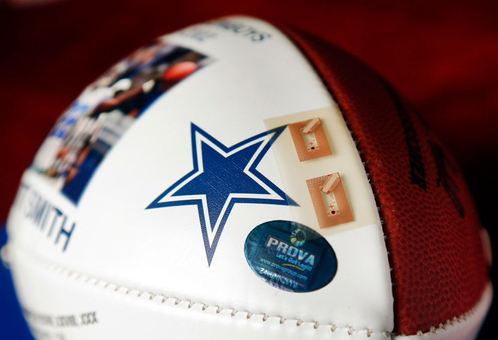 A near-field communication chip like this is embedded under the leather of Dallas Cowboys Hall of Fame running back Emmitt Smith's football at his Addison office. The tech-enabled system helps legitimize sports memorabilia, but could also be linked to more information about the collectors' item.