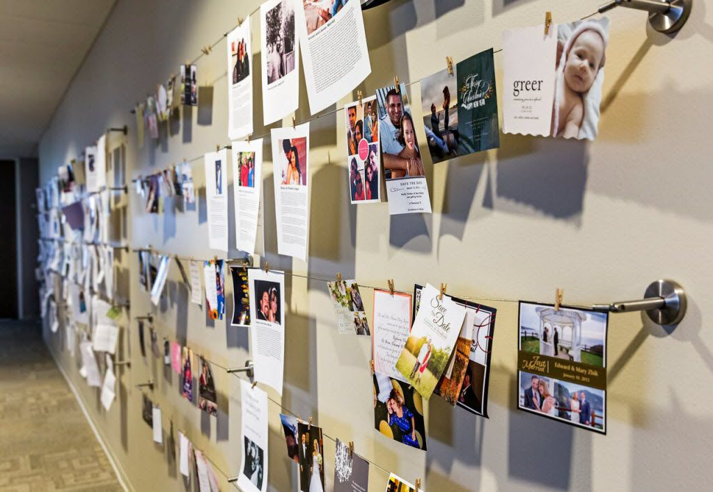 At Match's Dallas headquarters, a wall full of letters and photos from members and former members chronicles successes with the dating site.