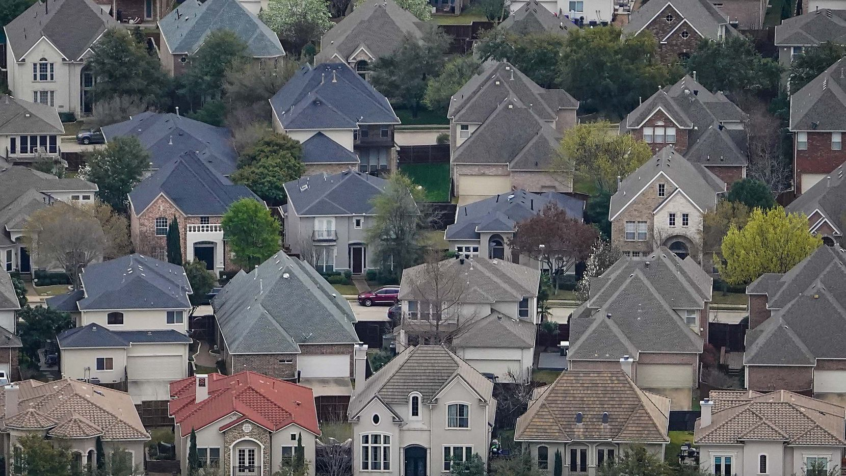 Aerial view of residential subdivisions near Las Colinas on Thursday, March 12, 2020, in Irving.