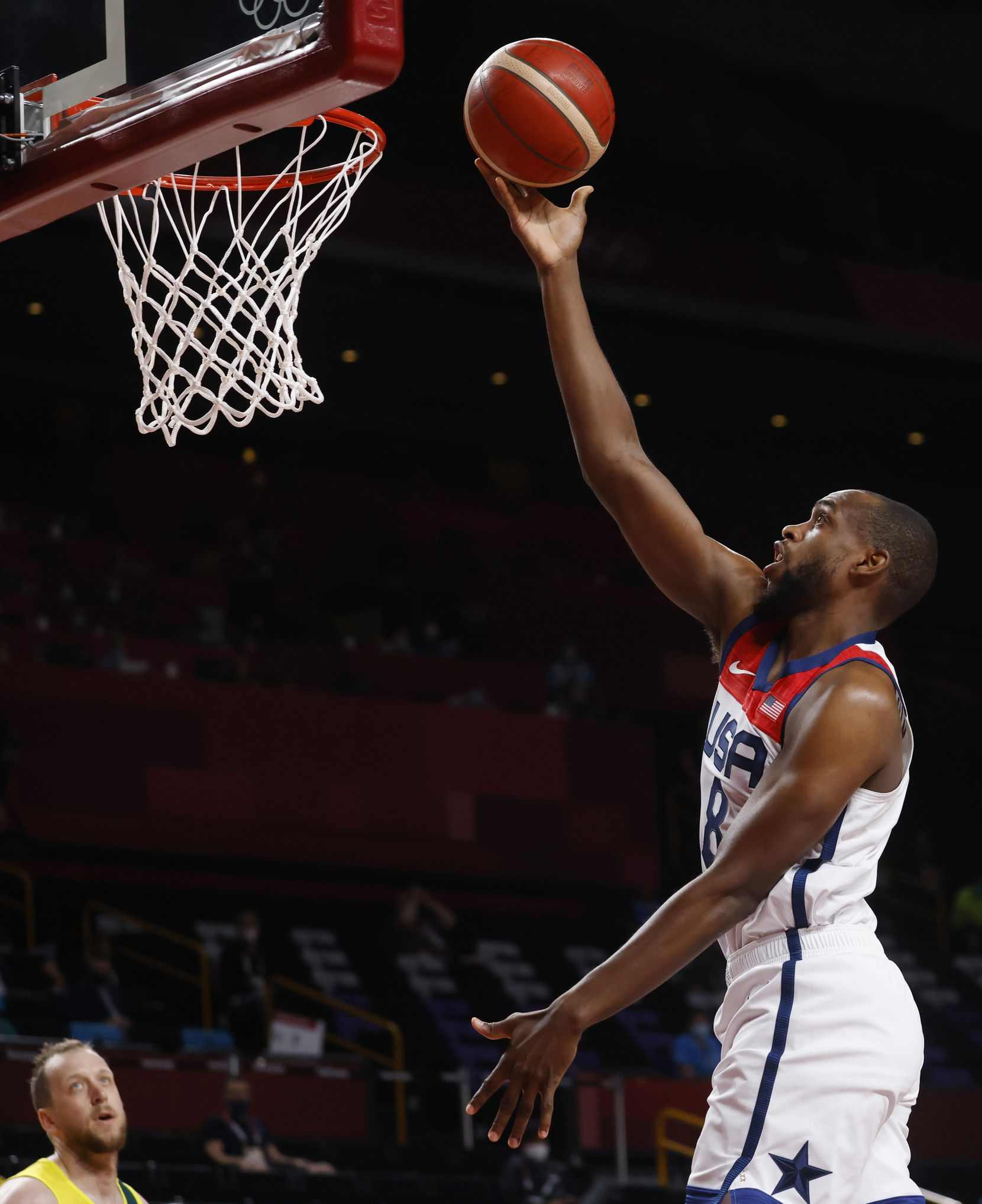 USA's Khris Middleton (8) attempts a layup in a game against Australia during the first half of a men's basketball semifinal at the postponed 2020 Tokyo Olympics at Saitama Super Arena, on Thursday, August 5, 2021, in Saitama, Japan. USA defeated Australia 97-78 to advance to the gold medal game. (Vernon Bryant/The Dallas Morning News)