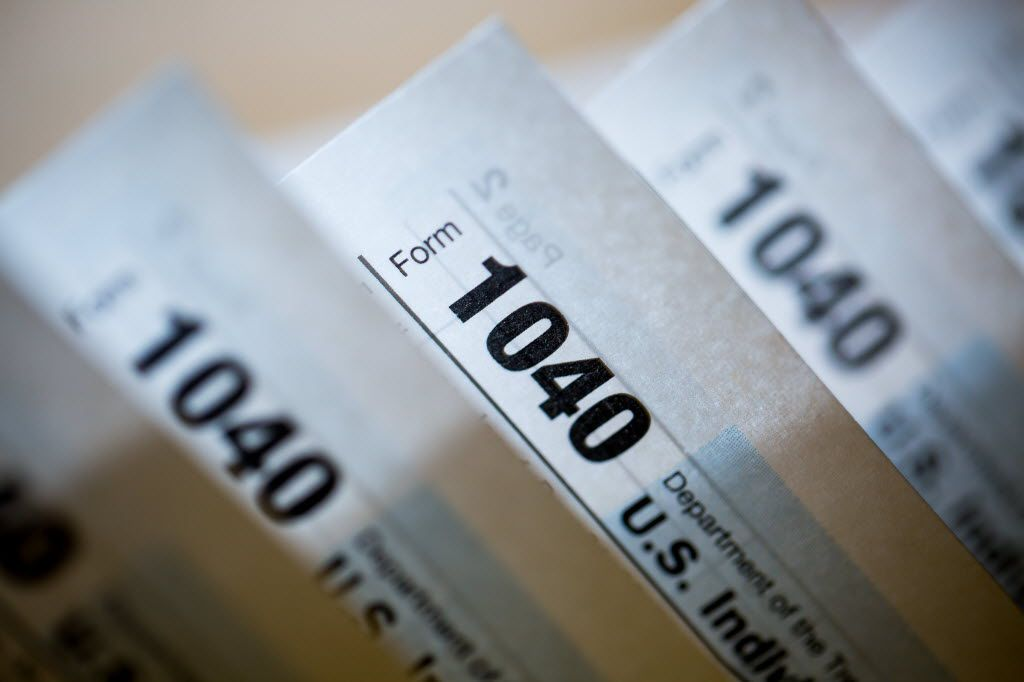 U.S. Department of the Treasury Internal Revenue Service 1040 Individual Income tax forms for the 2015 tax year.  (File Photo/Bloomberg)