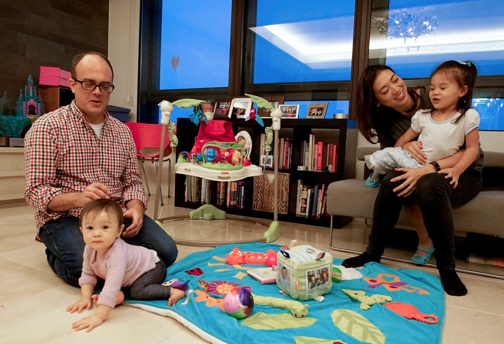 Elise Hu, NPR reporter, spends time with her husband, Matt Stiles, and daughters Isa, 2, and Luna, who is 9 months old, at their apartment in Seoul, South Korea.