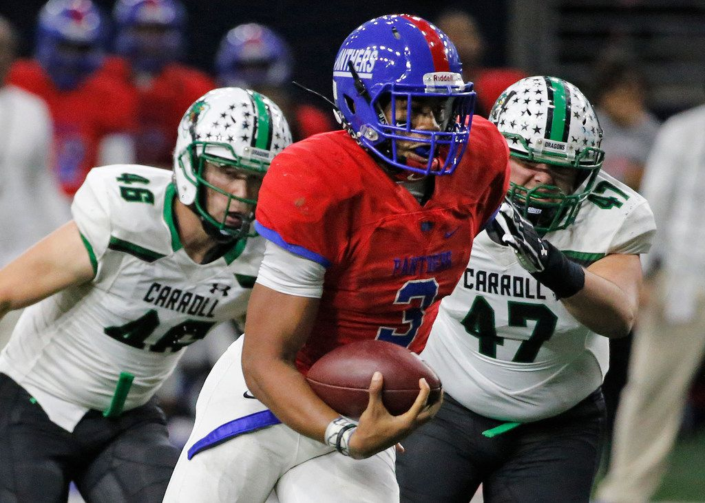 Duncanville quarterback Ja'Quinden Jackson runs for yardage past Carroll defenders Thomas Wrehe (46) and Alex Kingston (47) in the third quarter during the Southlake Carroll Dragons vs. the Duncanville Panthers Class 6A Division I Region I high school football playoff game at the Star in Frisco, Texas on Saturday, December 8, 2018. (Louis DeLuca/The Dallas Morning News)