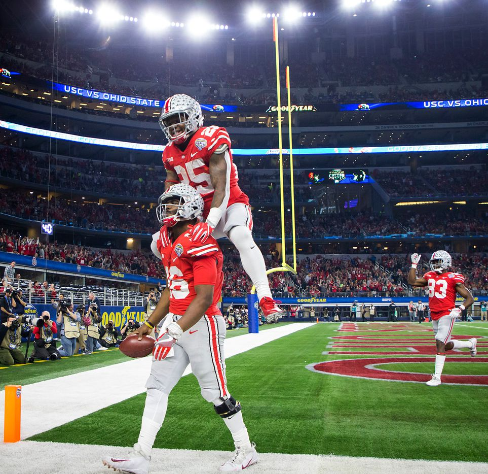 Ohio State running back Mike Weber (25) leaps on quarterback J.T. Barrett (16) after Barrett scored on a 28-yard touchdown run during the second quarter of the Cotton Bowl against USC on Friday, Dec. 29, 2017, in Arlington, Texas. (Smiley N. Pool/The Dallas Morning News)