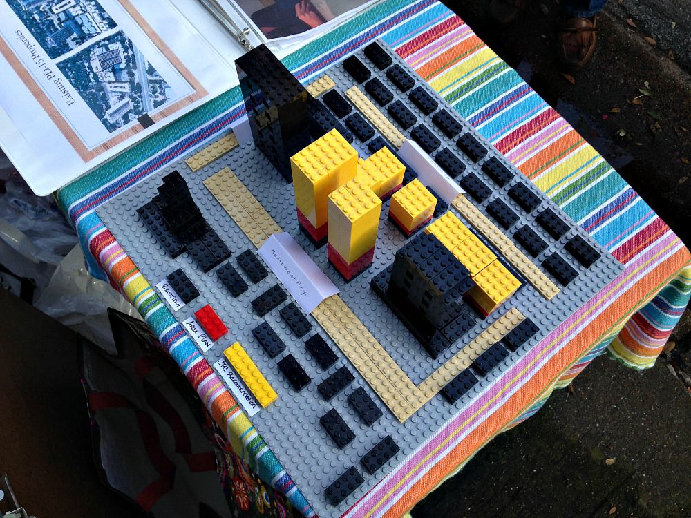 This Lego model of PD15 was on display at Monday's block party/protest. The red is as high as some residents say they're willing to go.