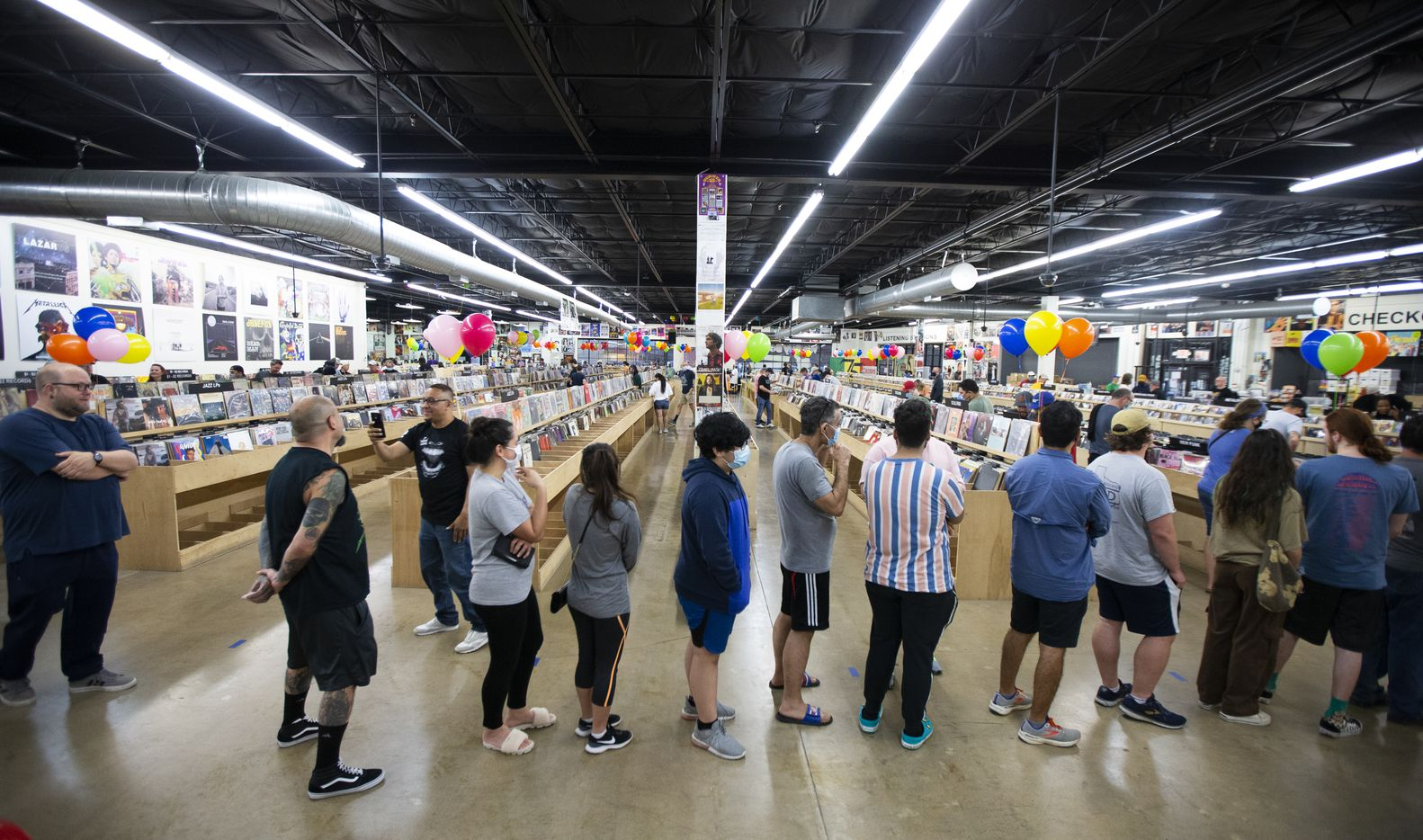 """Customers wind their way into the store, where new releases including the """"Truth To Power"""" record went on sale Saturday morning."""