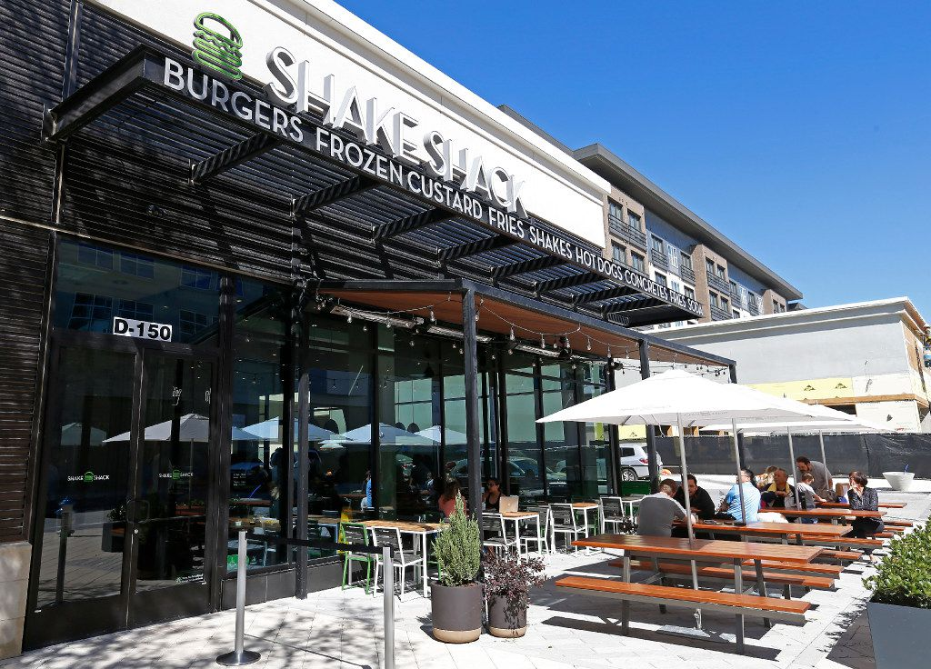 Diners eat lunch in the patio area at Shake Shack that opens its store in the mixed-use Legacy West development in Plano, Texas, Wednesday, March 29, 2017. (Jae S. Lee/The Dallas Morning News)