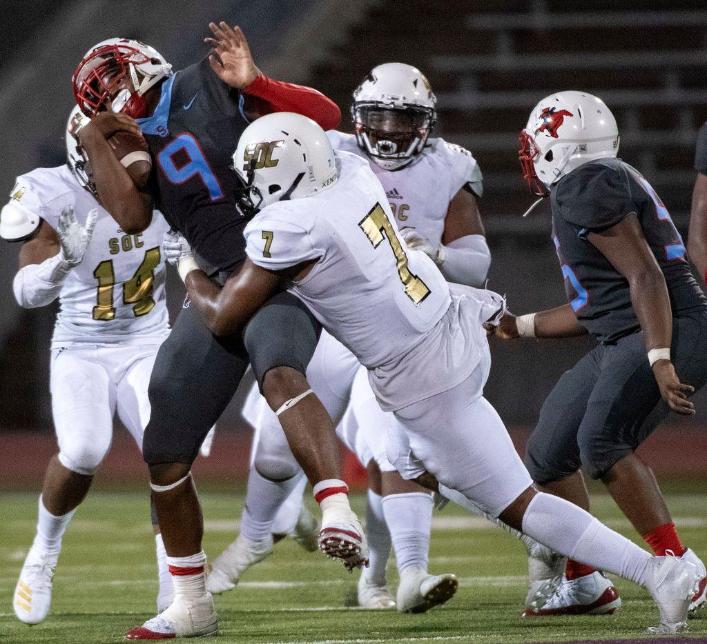 South Oak Cliff linebacker Jai Jones (7) hits Skyline quarterback Darryl Richardson (9) during South Oak Cliff's 22-21 win last season. (Jeffrey McWhorter/Special Contributor)