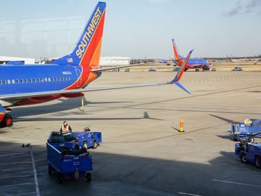 Southwest planes sit on the runway at Dallas Love Field Airport in Dallas on Dec. 23.