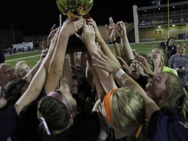 Frisco Wakeland players hoist the state semifinal trophy after beating Grapevine 3-2 in a Class 5A semifinal Tuesday. (Steve Hamm/ Special Contributor)