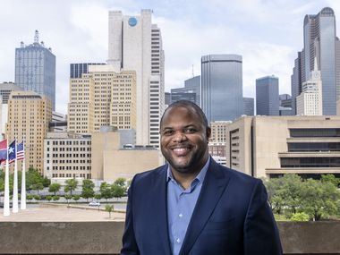 "Mayor Eric Johnson on the balcony outside his office at Dallas City Hall on Thursday after an interview with The Dallas Morning News. ""I am willing to do whatever it takes to advance this agenda on behalf of the city of Dallas,"" Johnson told Metro columnist Sharon Grigsby."