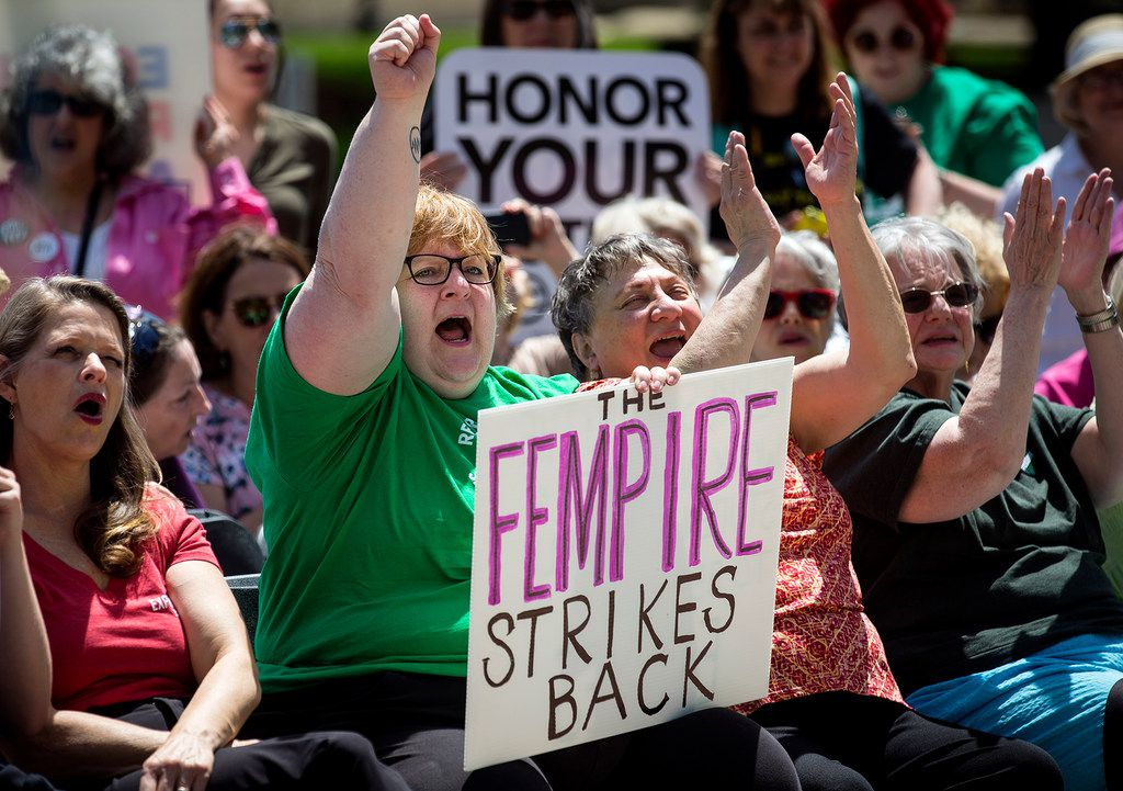 Supporters of the Equal Rights Amendment urged the Illinois House to pass a joint resolution to ratify the constitutional amendment during a rally May 8.