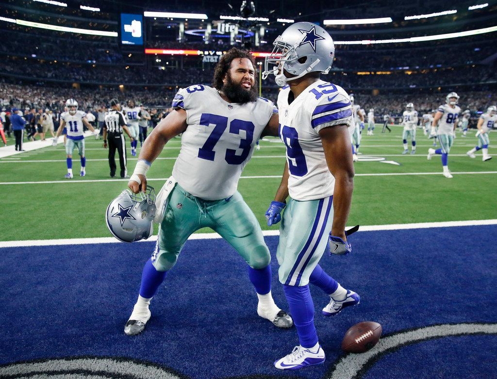 FILE - Cowboys receiver Amari Cooper (19) is congratulated by center Joe Looney (73) after scoring a game-winning touchdown in overtime against the Eagles at AT&T Stadium in Arlington on Sunday, Dec. 9, 2018. The Cowboys won 29-23. (Tom Fox/The Dallas Morning News)