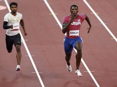 USA's Fred Kerley (right) and Barakat Al Harthi (left) race to the finish in heat 5 of 7 race of the 100 meter qualifying race during the postponed 2020 Tokyo Olympics at Olympic Stadium, on Saturday, July 31, 2021, in Tokyo, Japan. Kerley finished second with a time of 9.97 seconds to qualify for the next round.