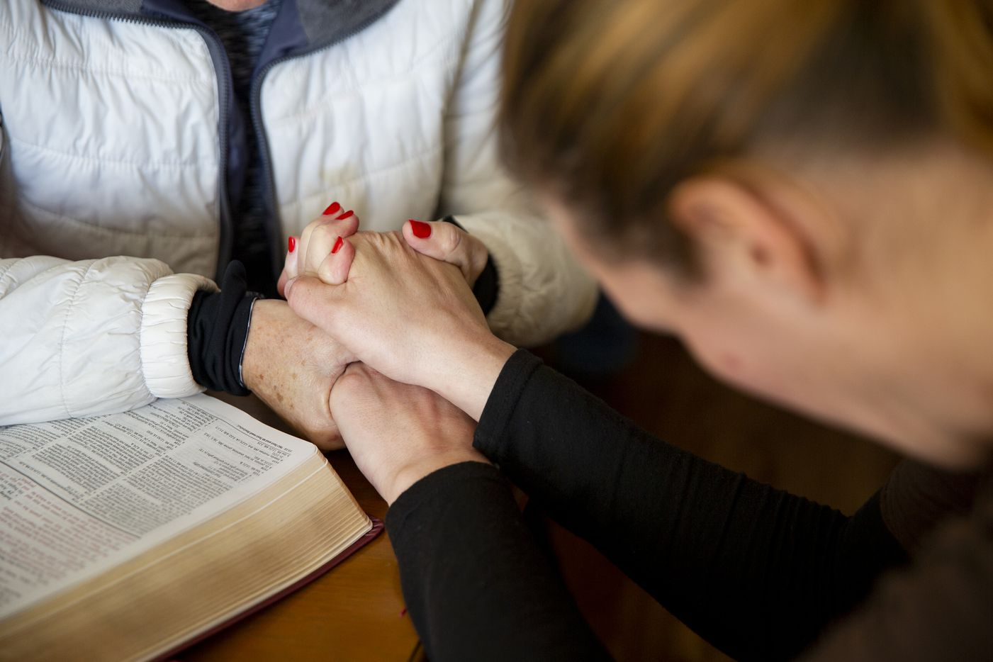 Jennifer Birdd prayed over a member of her congregation on Jan. 5, the first Sunday after losing the S.O.U.L. Church lot. The Birdds have helped many in their congregation recover from difficulties through faith and care.