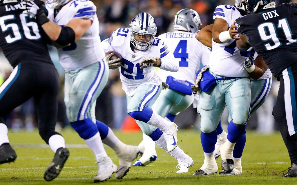 FILE - Cowboys running back Ezekiel Elliott (21) looks for a hole in the Eagles' defense during a game at Lincoln Financial Field in Philadelphia on Sunday, Nov. 11, 2018. (Tom Fox/The Dallas Morning News)