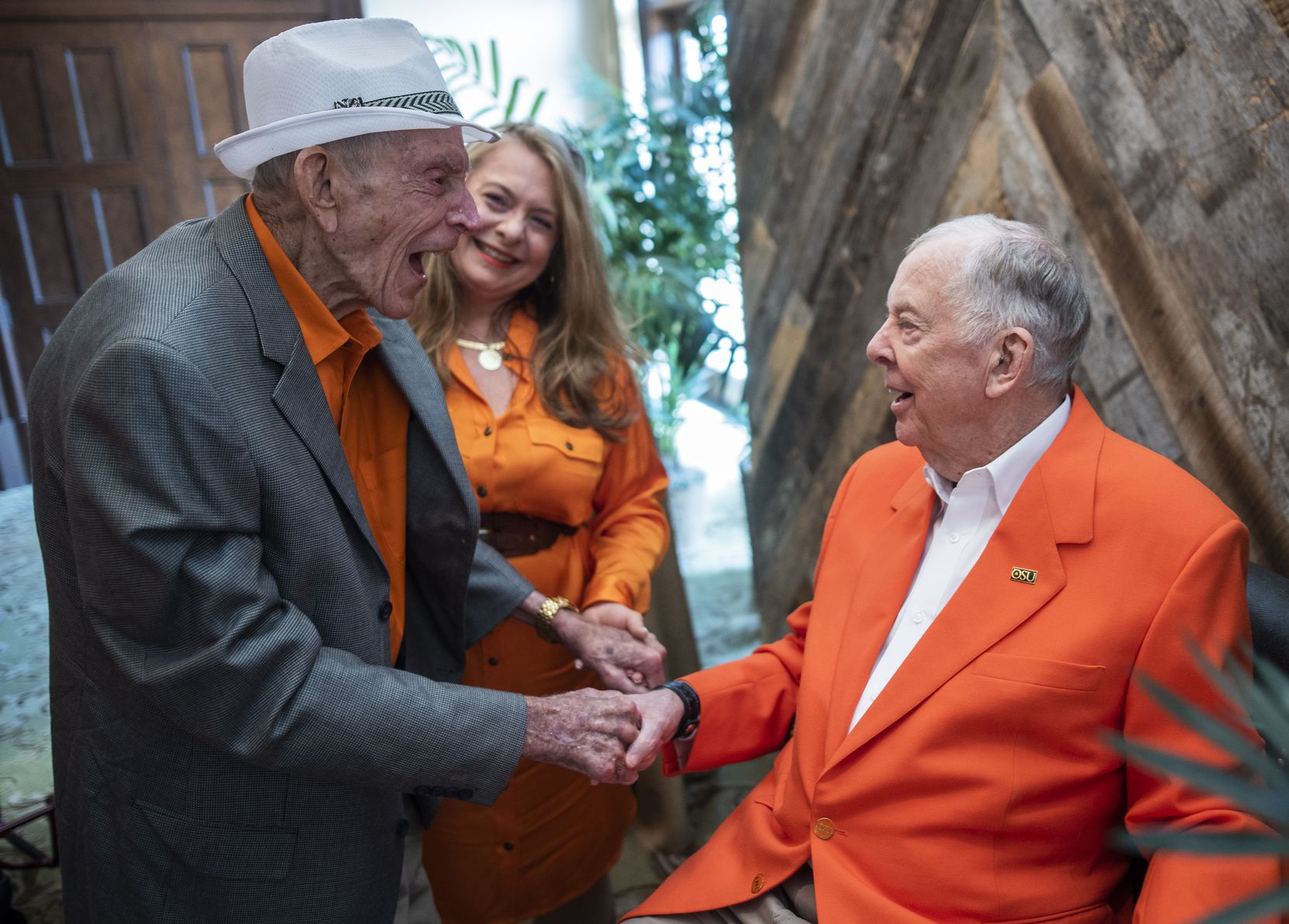 Jim Moeller (left) greeted Pickens at his 90th birthday party at the Dallas Country Club on May 19, 2018.  They went to junior high together in Holdenville.