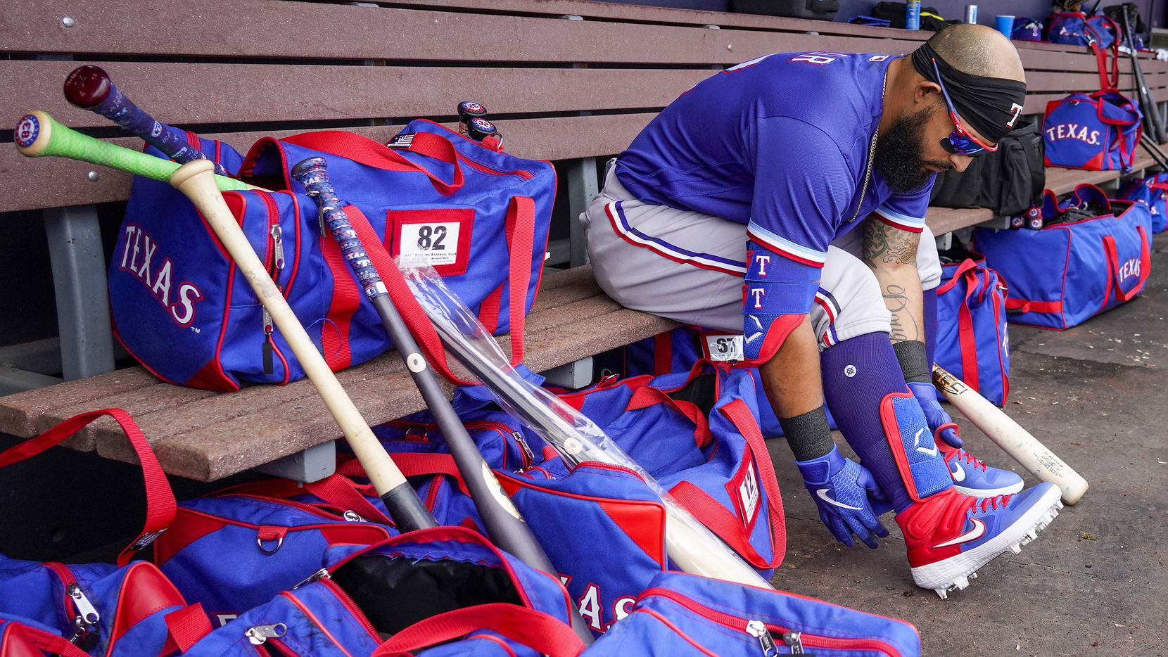 Texas Rangers second baseman Rougned Odor puts on his gear before a spring training game against the Seattle Mariners at Peoria Sports Complex on Sunday, Feb. 23, 2020, in Peoria, Ariz.