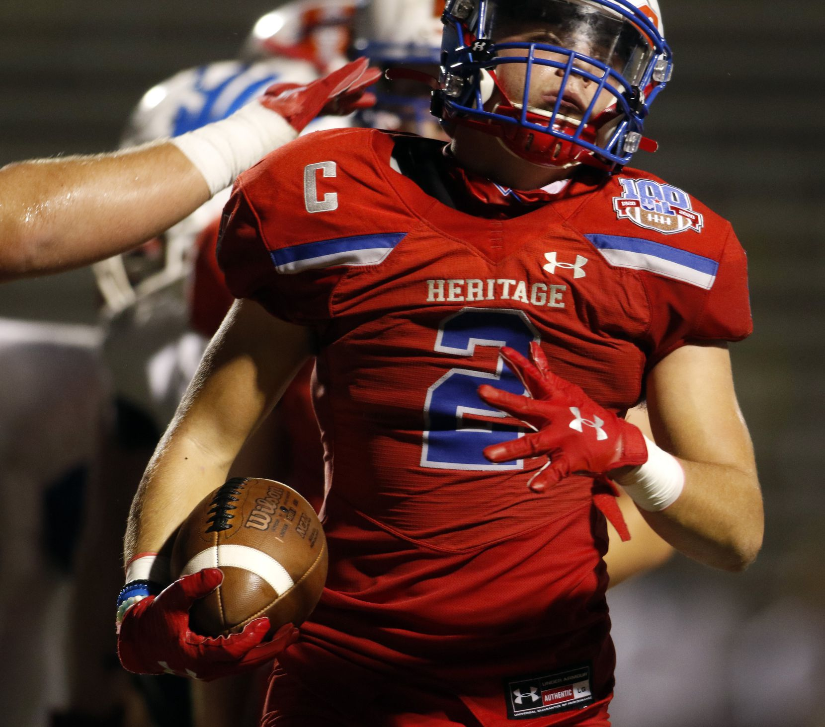 Midlothian Heritage running back Cullen Stone (2) receives a pat on the back from a teammate following a fourth quarter rushing touchdown. The two teams played their Class 4A football game at Midlothian ISD Multipurpose Stadium in Midlothian on September 4, 2020. (Steve Hamm/ Special Contributor)