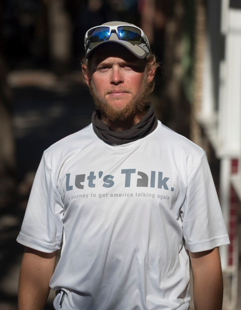 Andrews  is walking across the country to promote face-to-face communication.
