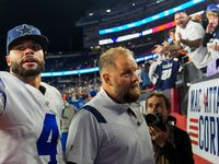 Dallas Cowboys quarterback Dak Prescott tosses his wristbands to the crowd after an overtime victory over the New England Patriots in NFL football game against the New England Patriots on Sunday, Oct. 17, 2021, in Foxborough, Mass.