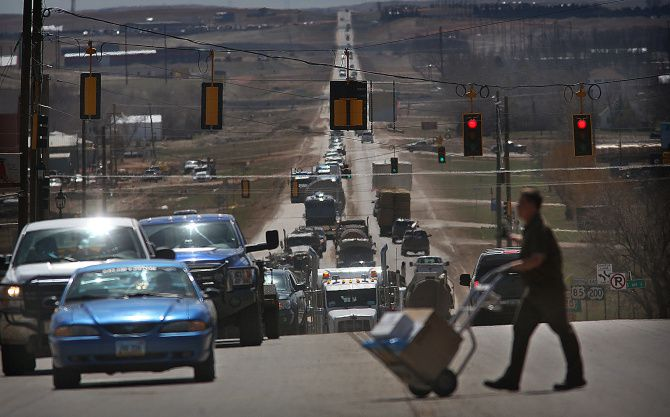 Traffic in Watford City, N.D., is heavy most of the day as trucks and other vehicles of all sizes approach a major highway intersection.