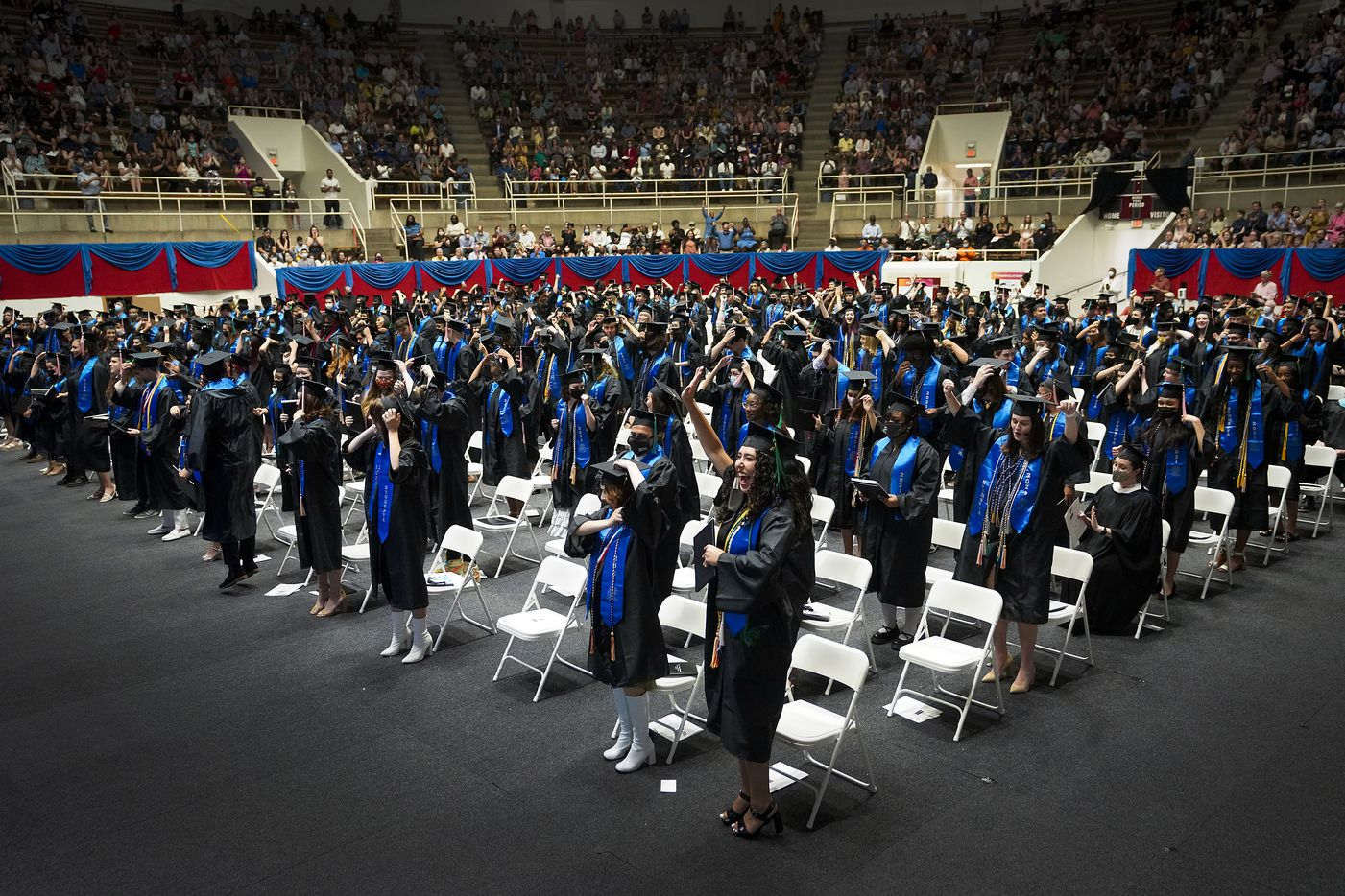 Graduates celebrate after the turning of the tassel during commencement ceremonies for Booker T. Washington HSPVA at Loos Field House on Saturday, June 19, 2021.