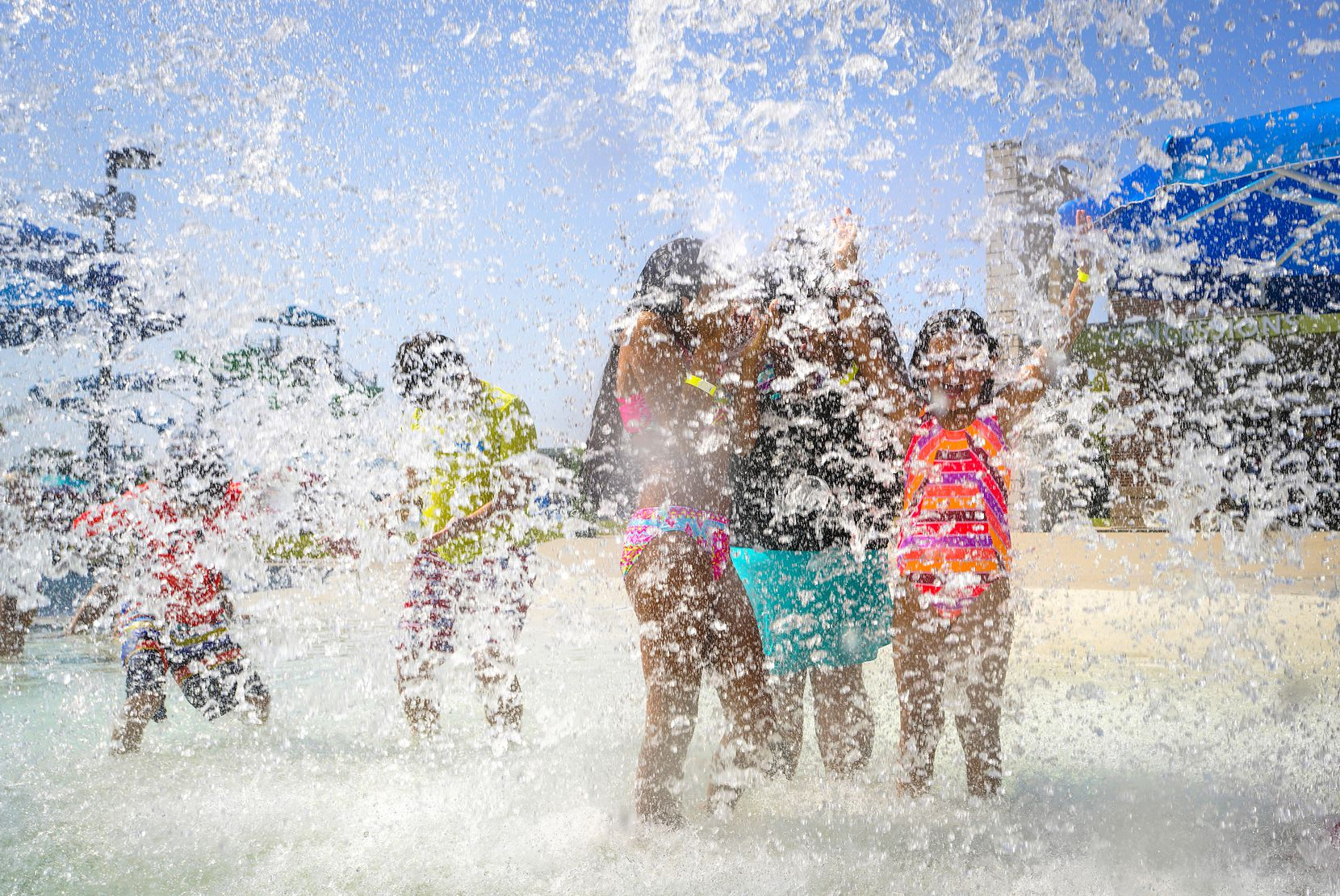 Children played in a cascade of water at the Frog Pond Water Park at Farmers Branch Aquatics Center last August.