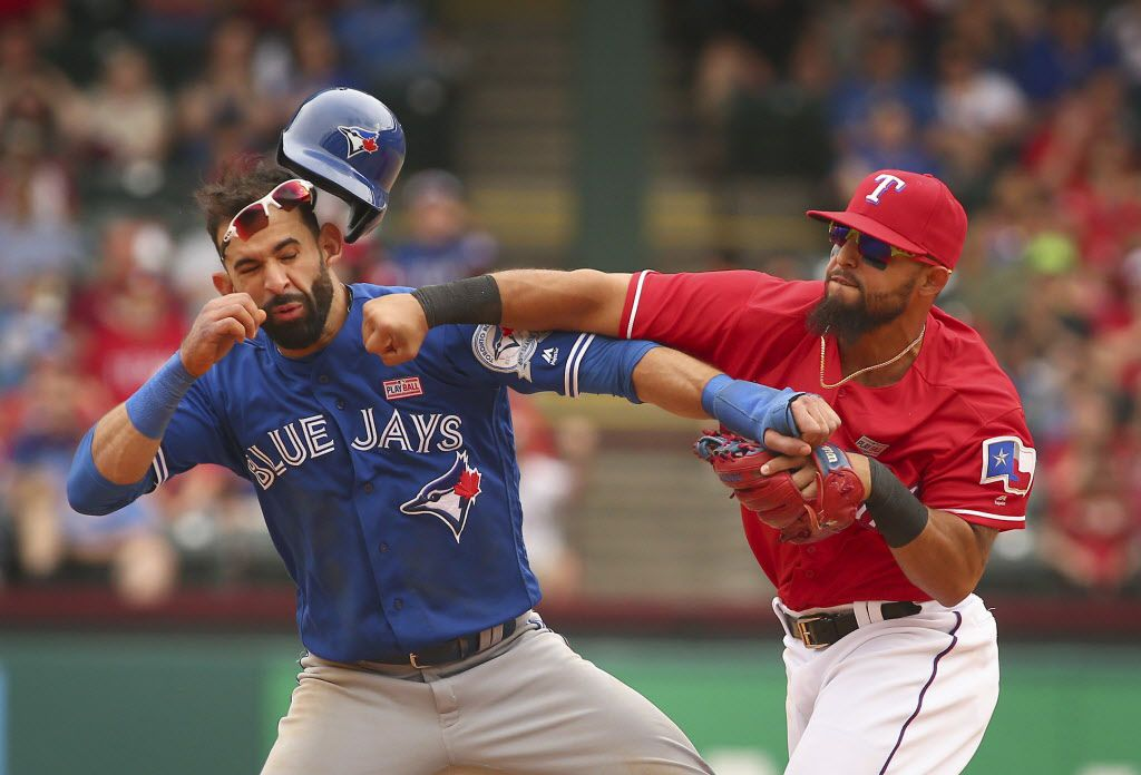 FILE - In this May 15, 2016, file photo, Toronto Blue Jays' Jose Bautista, left, is hit by Texas Rangers second baseman Rougned Odor, right, after Bautista slid into second in the eighth inning of a baseball game at Globe Life Park in Arlington, Texas. (Richard W. Rodriguez/Star-Telegram via AP, File)