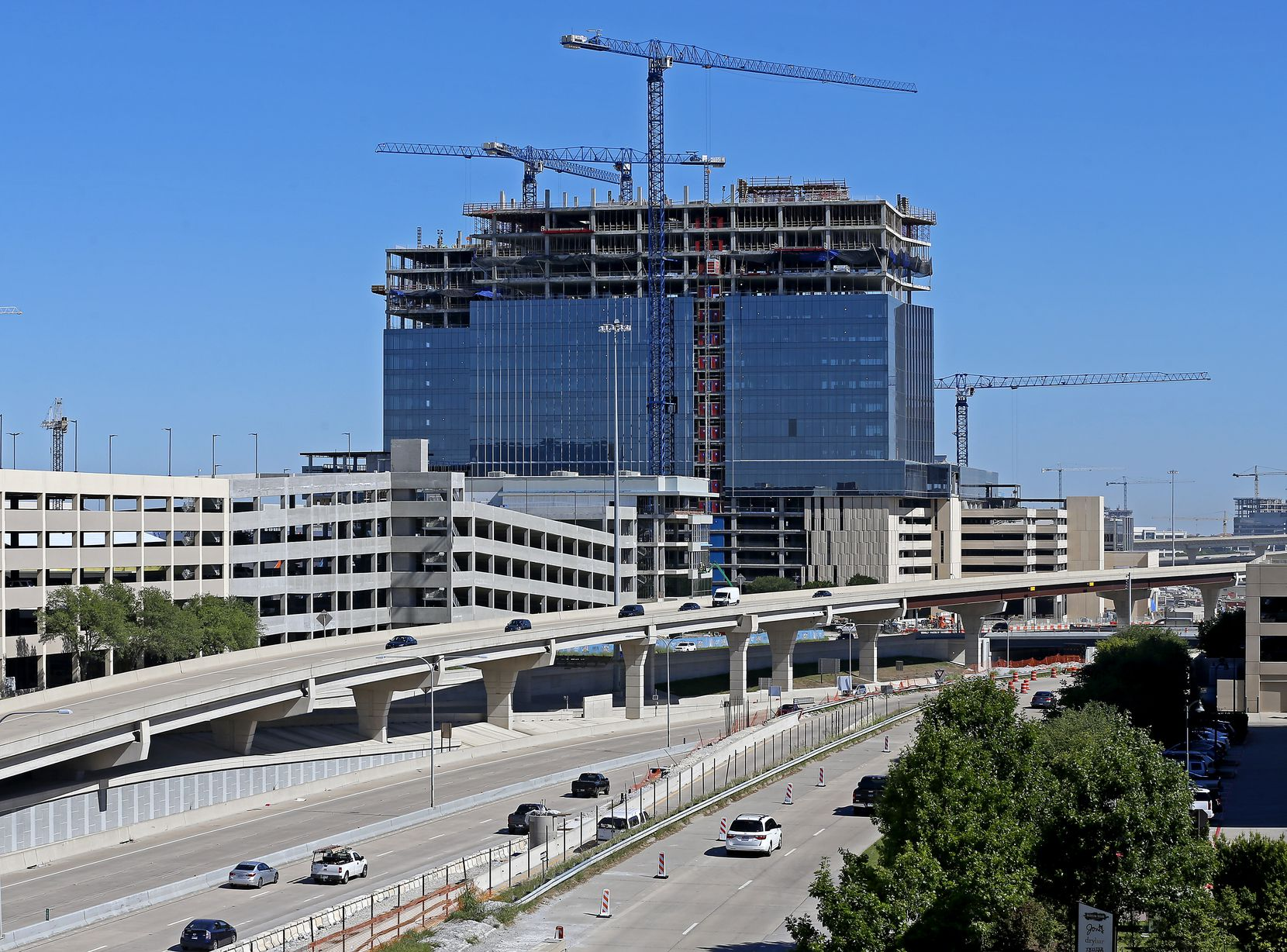 Liberty Mutual's 19-story office towers on the Dallas North Tollway will open later this year.
