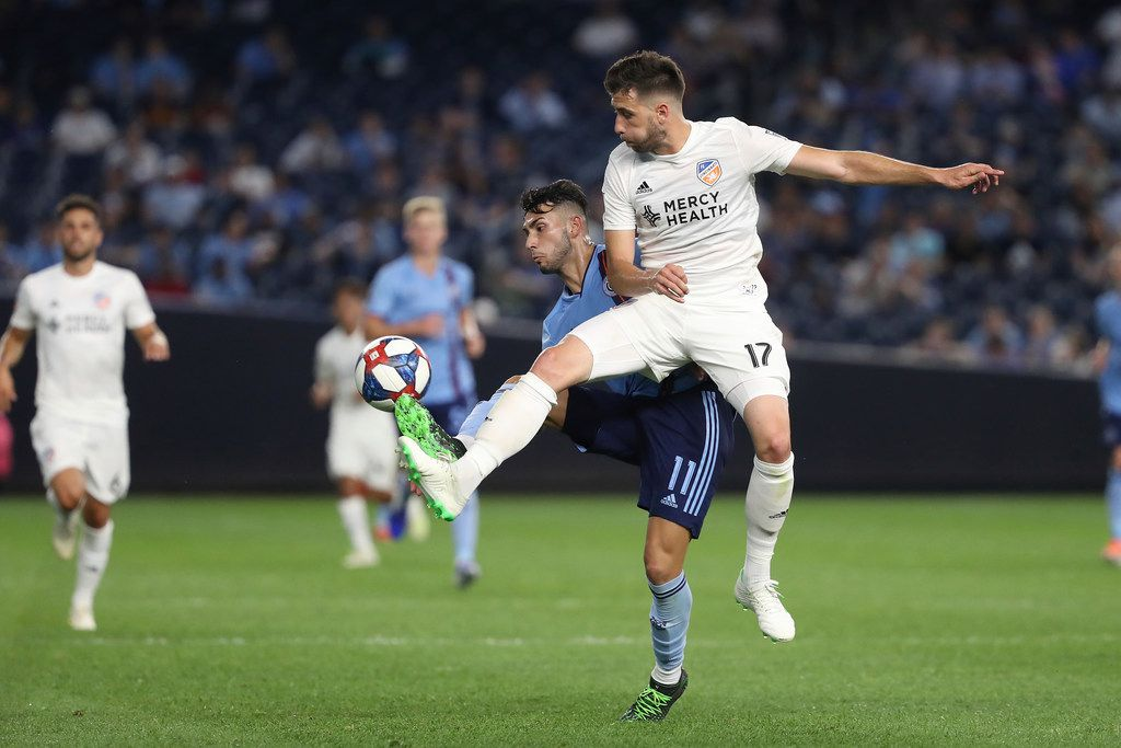 FC Cincinnati defender Mathieu Deplange, right, and New York City FC forward Valentin Castellanos both attempt to control the ball during the second half of an MLS soccer match, Thursday, June 6, 2019, in New York. New York City FC won 5-2. (AP Photo/Steve Luciano)