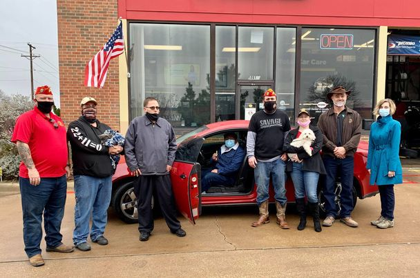 Joshua Alvarez (seated, in car) is an Army veteran who recently received a free vehicle through Project Spark, an initiative helping veterans in need find transportation. There for the giveaway, from left to right: Steven Sherman, Tarrant County Marine Corps League Commandant, Herb Anderson, DFW Devil Dogs Director, Midas Manager Marcus Boles, Alvarez, Patrick Murray, Senior Vice Commandant of the Department of Texas Marine Corps League, vehicle donors Katelyn & Shawn Vernon and Victoria Farrar-Myers, Arlington City Council member and Mayor Pro Tempore.