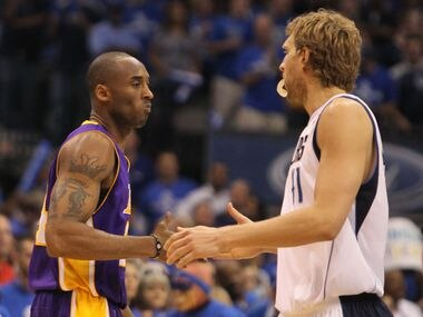 Los Angeles' Kobe Bryant and Dallas' Dirk Nowitzki shake hands before during Game 4 of the Western Conference Semifinals between the Los Angeles Lakers and the Dallas Mavericks at American Airlines Center in Dallas on Sunday May 8, 2011.