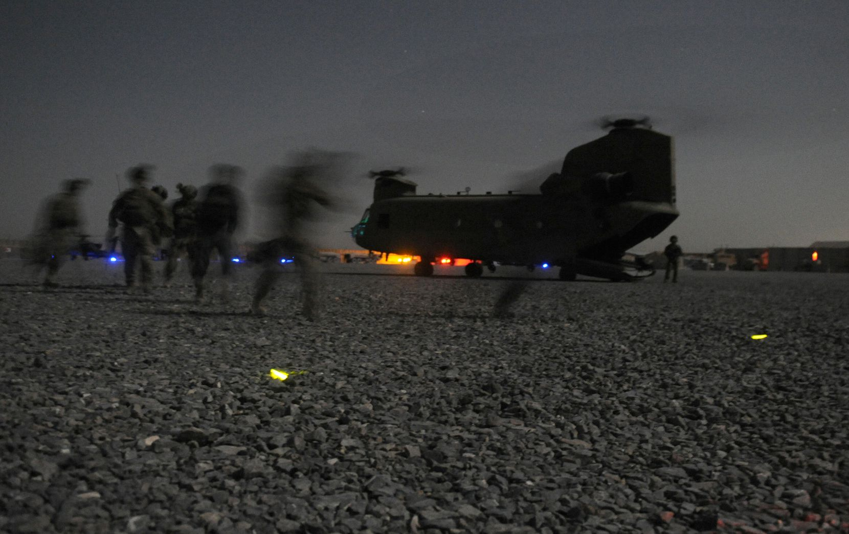 U.S. soldiers from Bravo Company, 2-87 Infantry Battalion, 3rd Brigade Combat Team and Afghan security forces conduct their final boarding maneuver before departing on a Chinook helicopter at Forward Operating Base Pasab in Zahri district, Kandahar province southern Afghanistan on August 15, 2011 to conduct a combined air and ground assault operation.