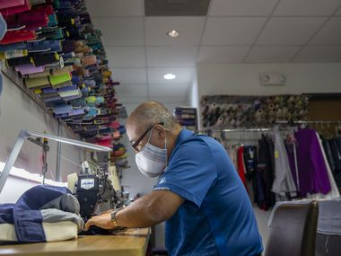 Owner John Seok works on alterations at Preston Royal Cleaners and Lucy's Tailor in Dallas on Wednesday, Oct. 14, 2020. The Seok family not only lost their business from the Oct. 20 tornadoes; they also had severe damage to their home. Three cars were totaled by the tornado and their damaged home was robbed. Then the COVID-19 pandemic led the owners to close the two other cleaners locations they owned while they focused on getting the Preston Royal location back up and running. (Lynda M. González/The Dallas Morning News)