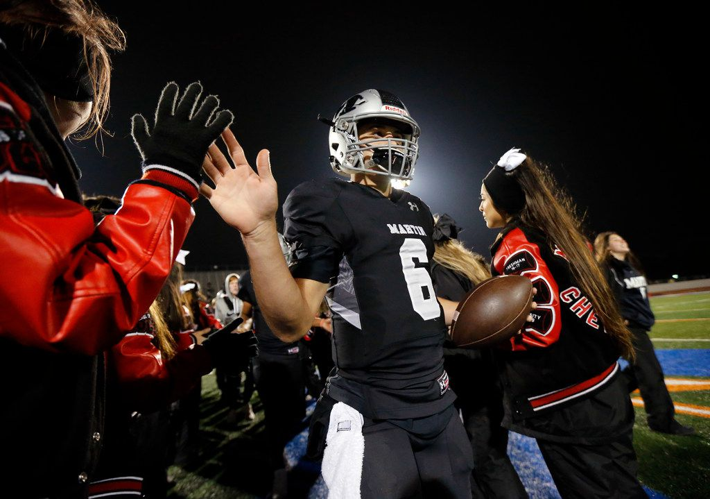 Martin quarterback Zach Mundell (6) is congratulated by cheerleaders after their District 4-6A title win over Bowie at Maverick Stadium in Arlington, Texas, Thursday, November 7, 2019. Martin won the title, 44-19. (Tom Fox/The Dallas Morning News)