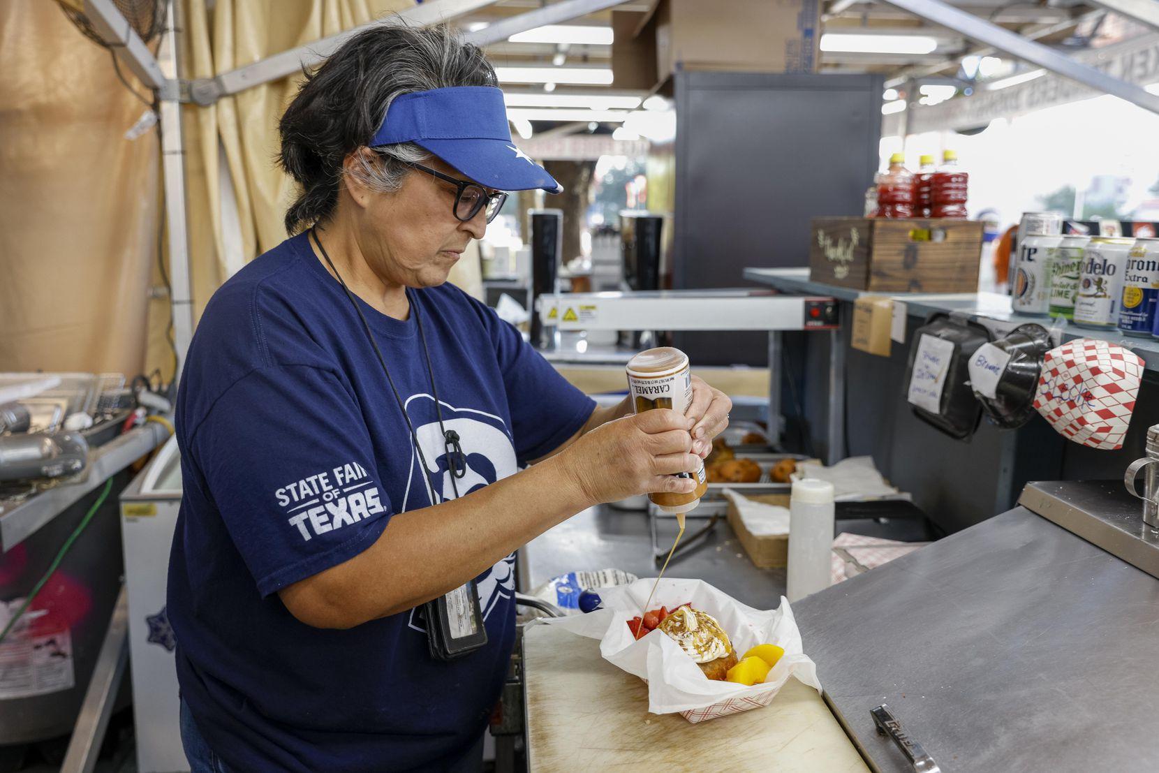 Denise Garza de la Cruz prepares a deep fried chocolate tres leches cake at the State Fair of Texas on Wednesday.